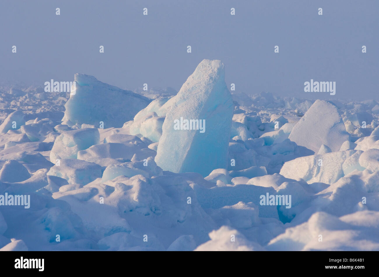 Frozen landscape of pressure ridges in the dynamic pack ice jumbled up from strong winds and currents over the Chukchi - Stock Image