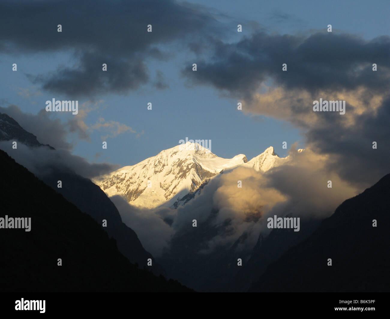 Annapurna 3 and Gandharba Chuli at dusk seen from Chhomrong, Annapurna foothills, Gandaki, Himalayas, Nepal, central - Stock Image