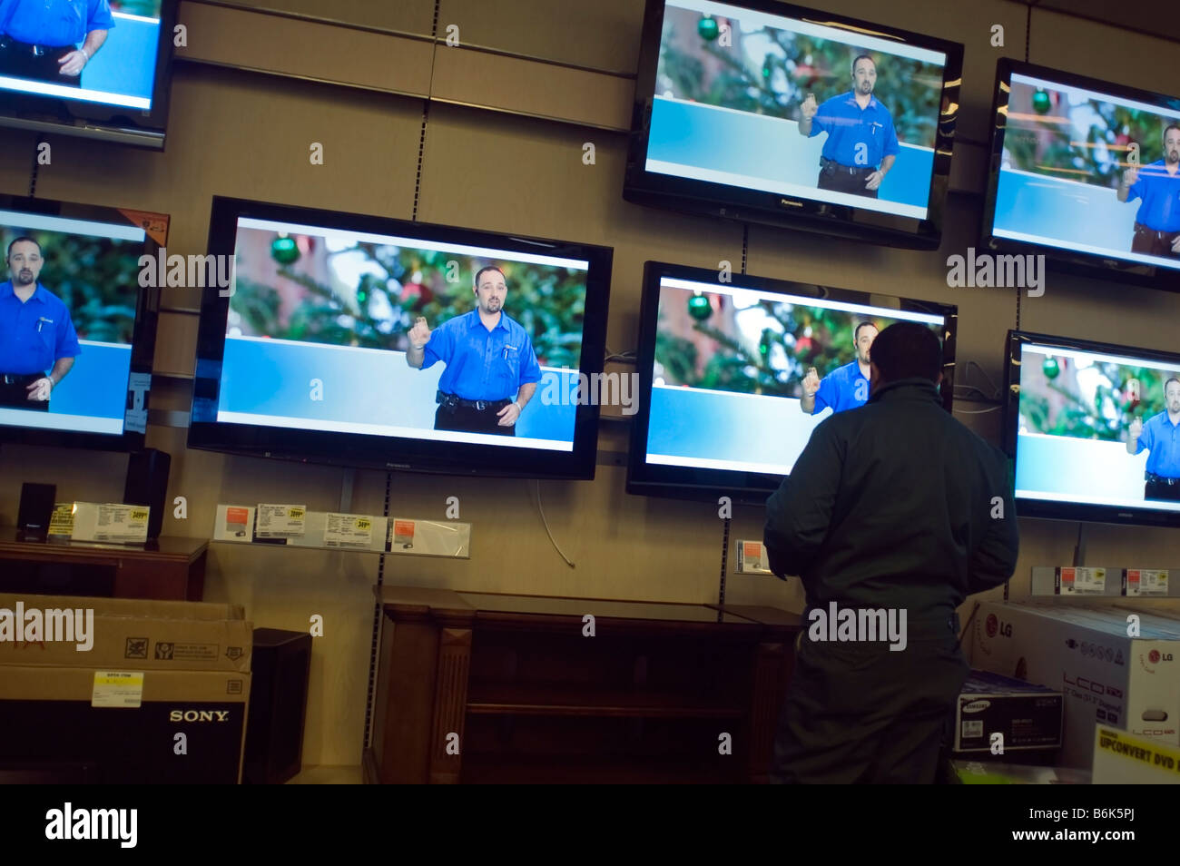 Customers Browse The Flat Screen Television Display At A Best Buy