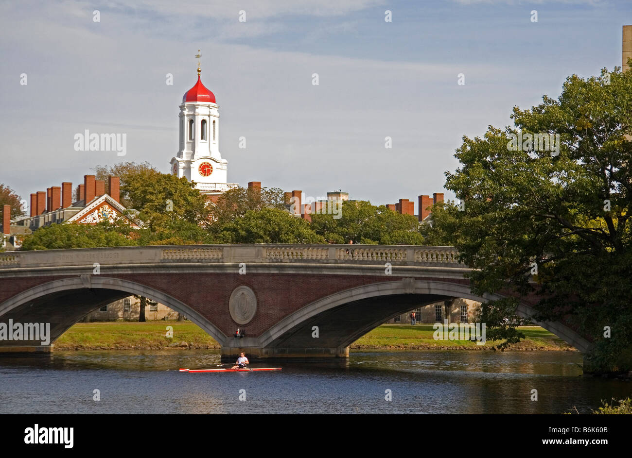Rowing on the Charles River and Harvard University buildings in Cambridge Greater Boston Massachusetts USA - Stock Image