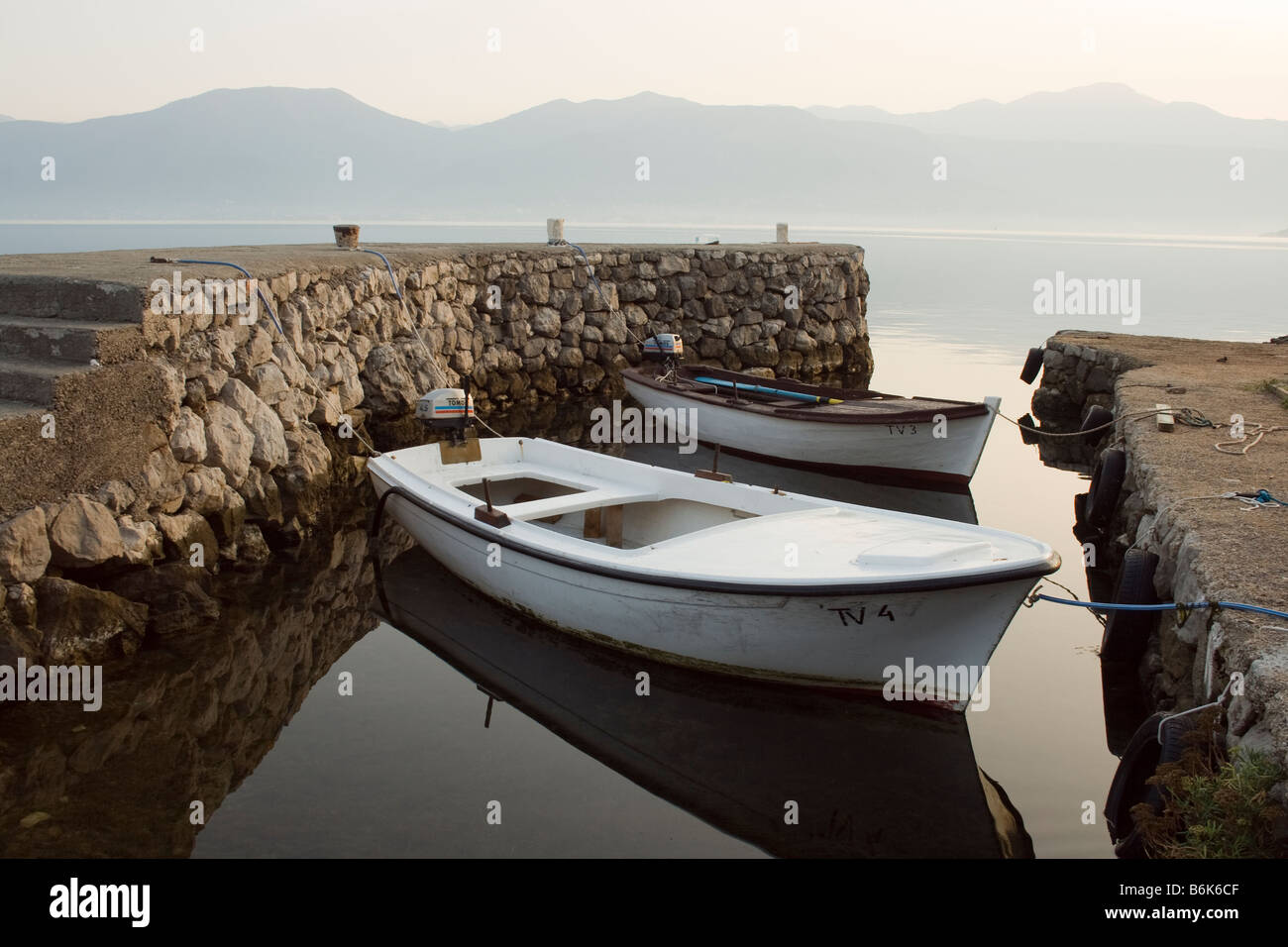 two wooden boats in a little bay in the morning, Kotor, Montenegro Stock Photo