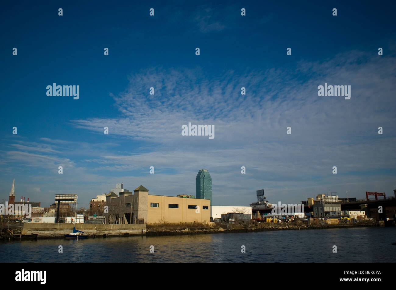 Newtown Creek an industrial waterway separating the boroughs of Brooklyn and Queens in New York - Stock Image