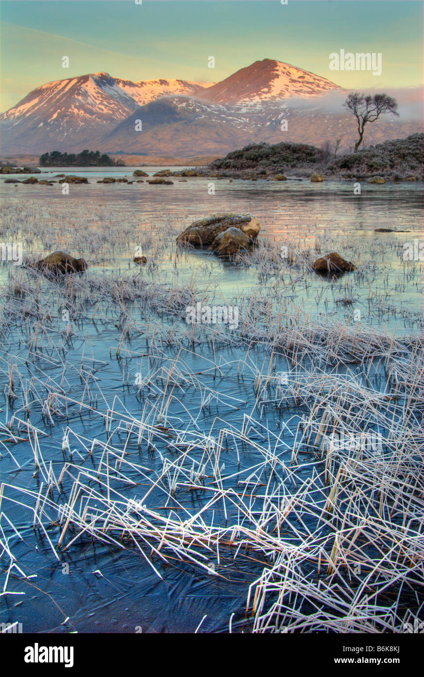 Lochan nah Achlaise in the foreground with the hills of the Black Mount behind in the Lochaber region of Scotland - Stock Image