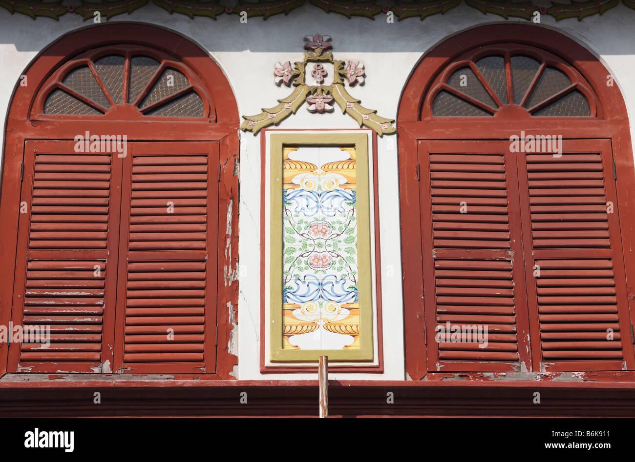 Shuttered Windows Of Renovated Peranakan Building, Melaka - Stock Image