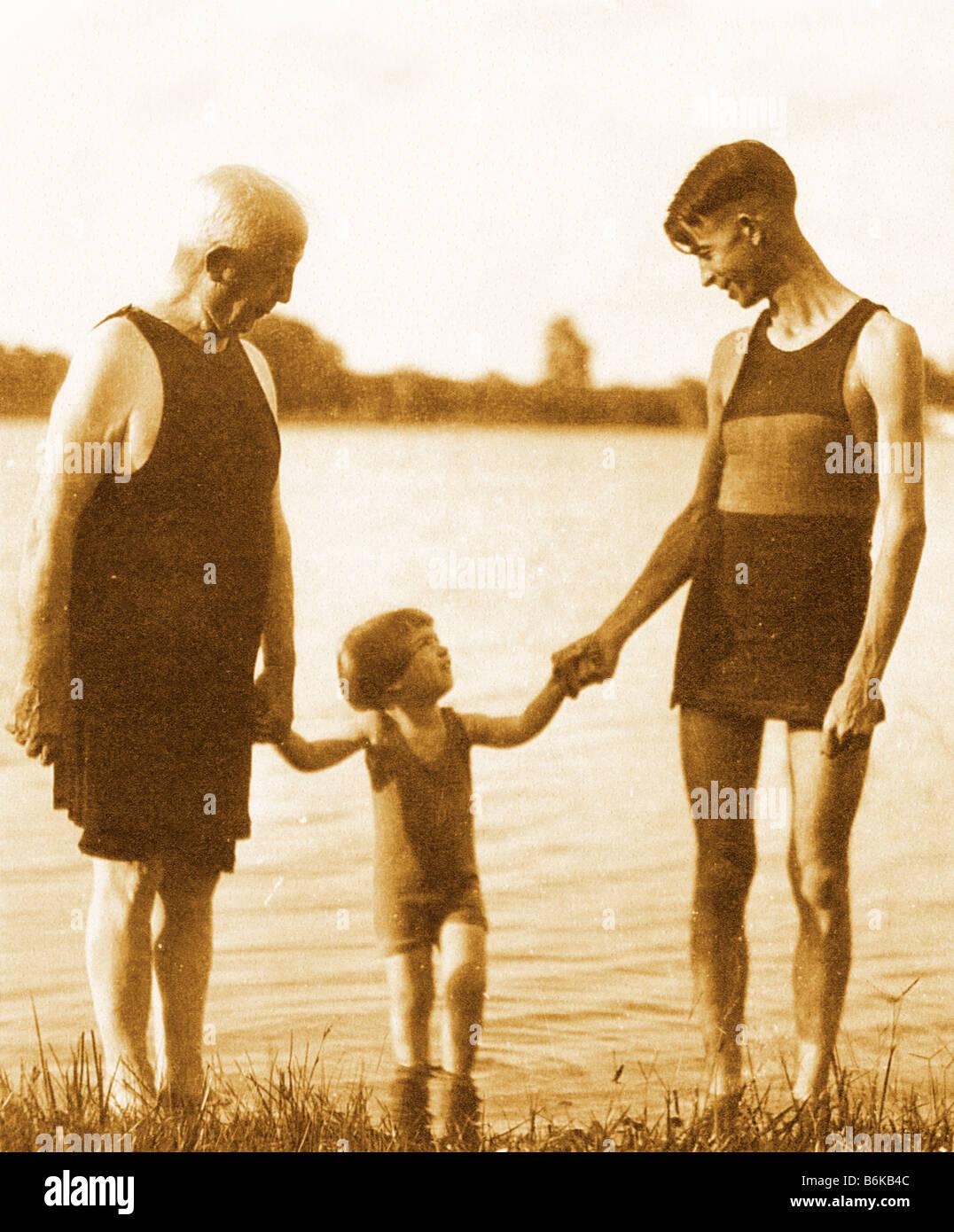 retro photo of three generations made circa 1920 by lake - Stock Image