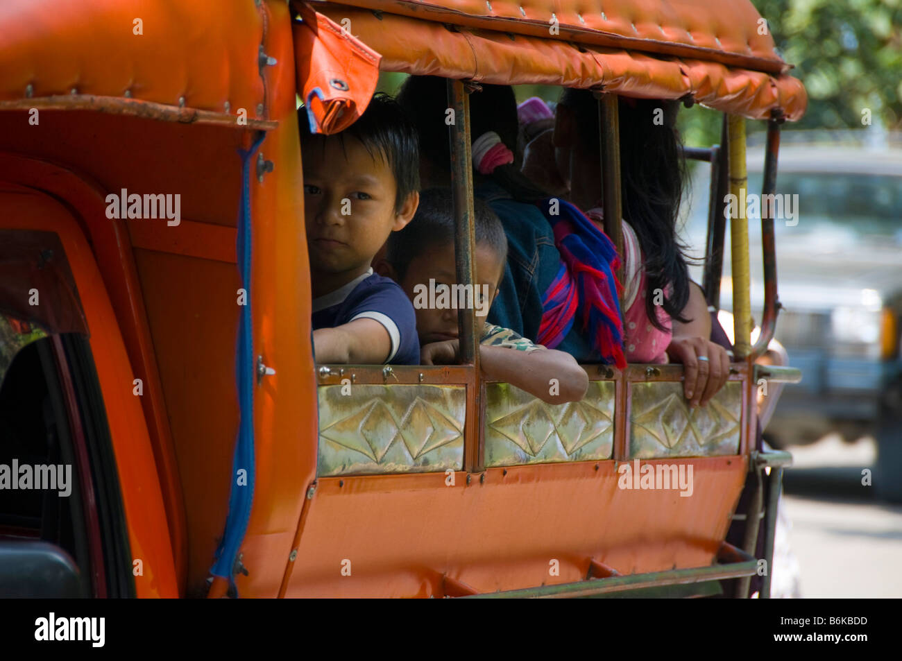 children in a public songthaew truck in northern Thailand - Stock Image