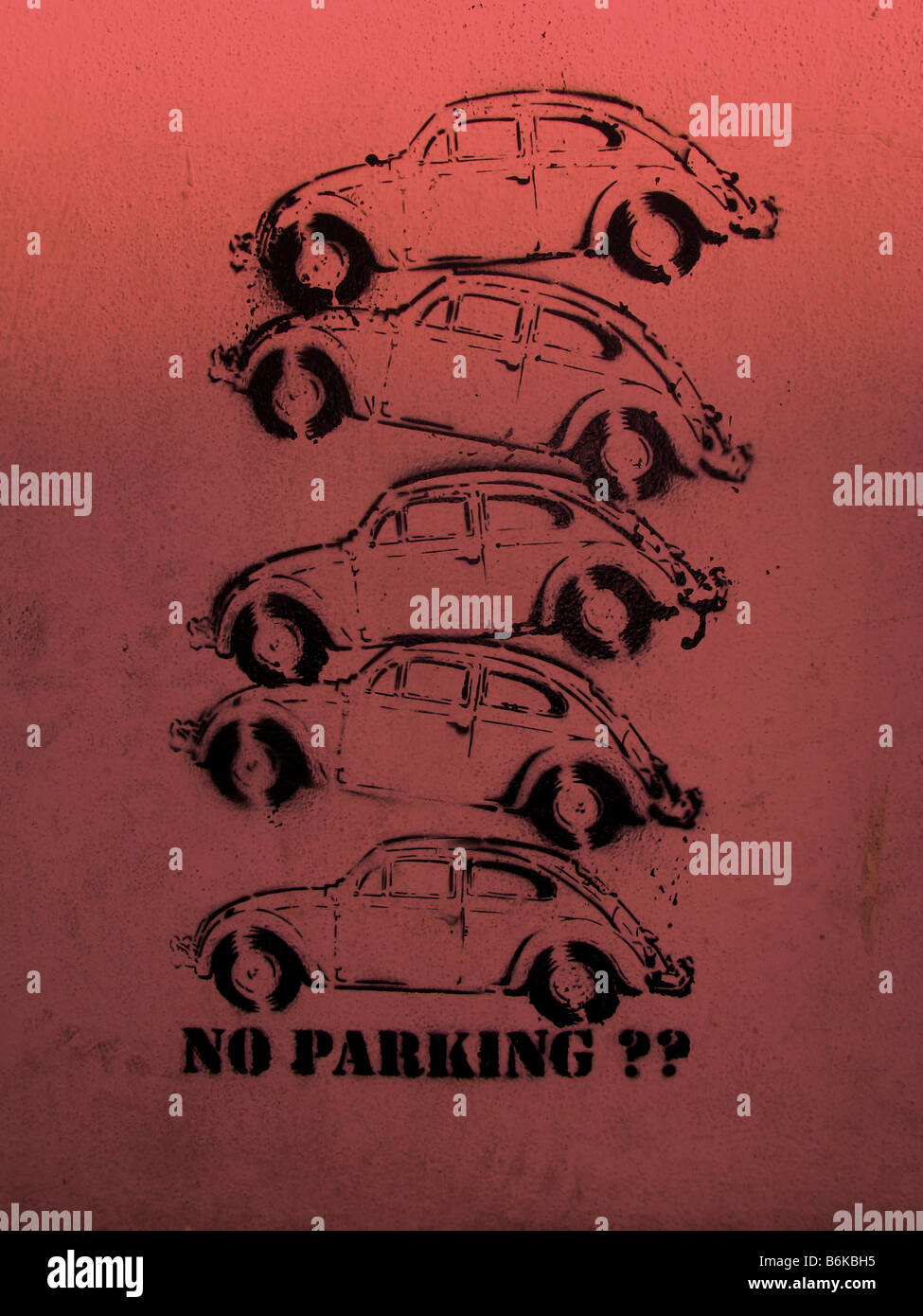 VW Beetle x 5.Poster print on a wall, no parking. Problem with parking, multi story parking on-top of each other. Stock Photo