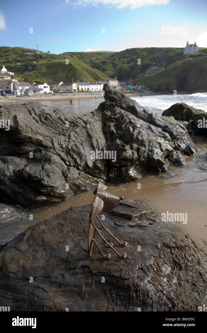 Llangrannog Beach Cardiganshire Cardigan bay Wales UK Rusty the metal dog - Stock Image