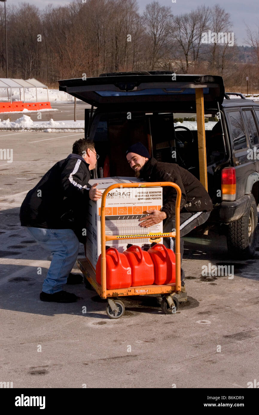 Emergency power generator loaded into the back of car after power outage. - Stock Image