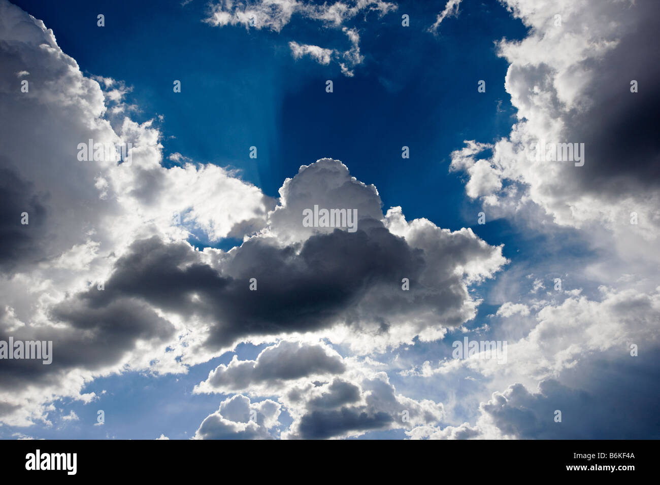 Dramatic clouds in blue sky - Stock Image