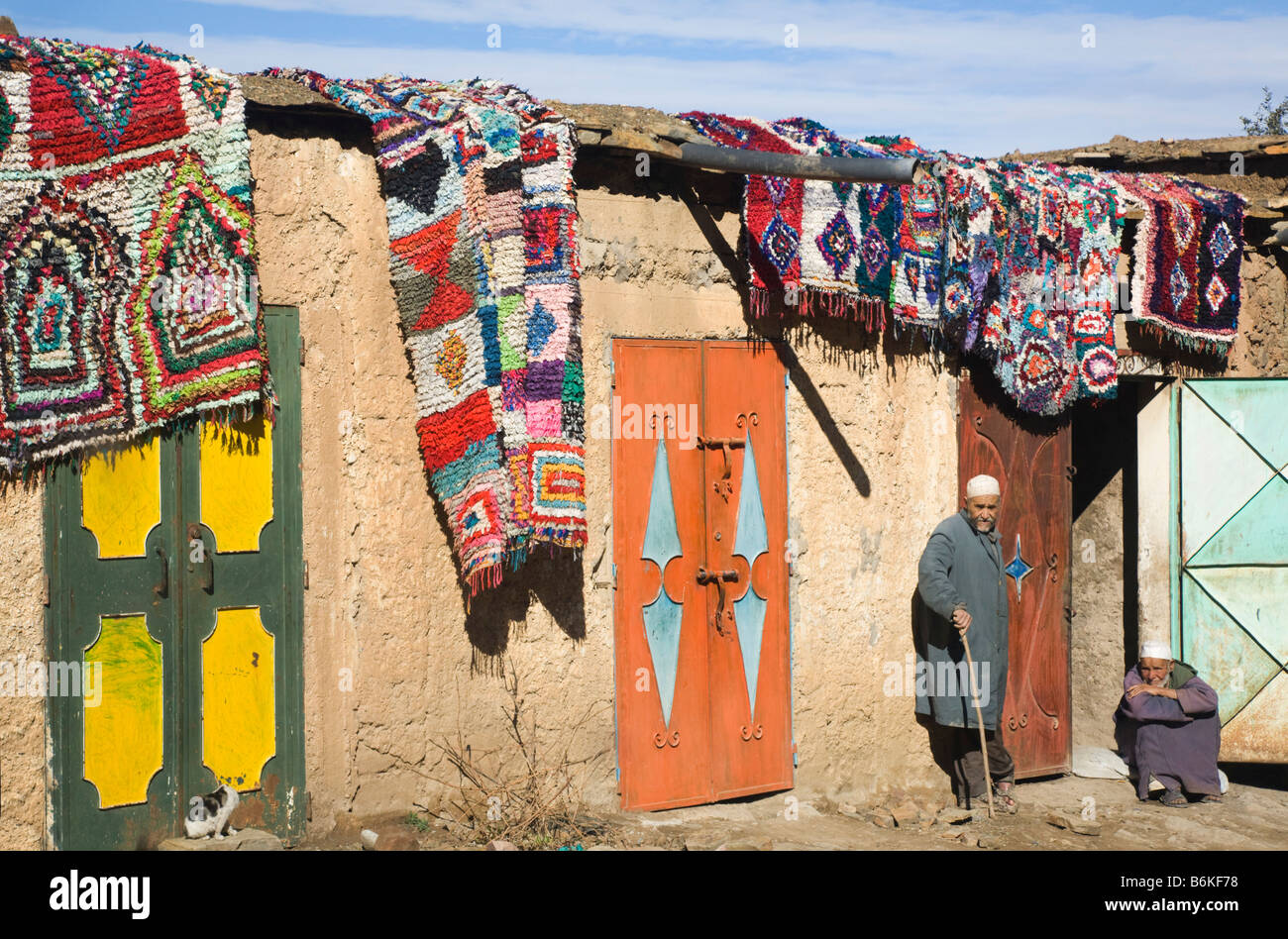 Traditional Moroccan Berber house with carpets hanging outside. Morrocco - Stock Image