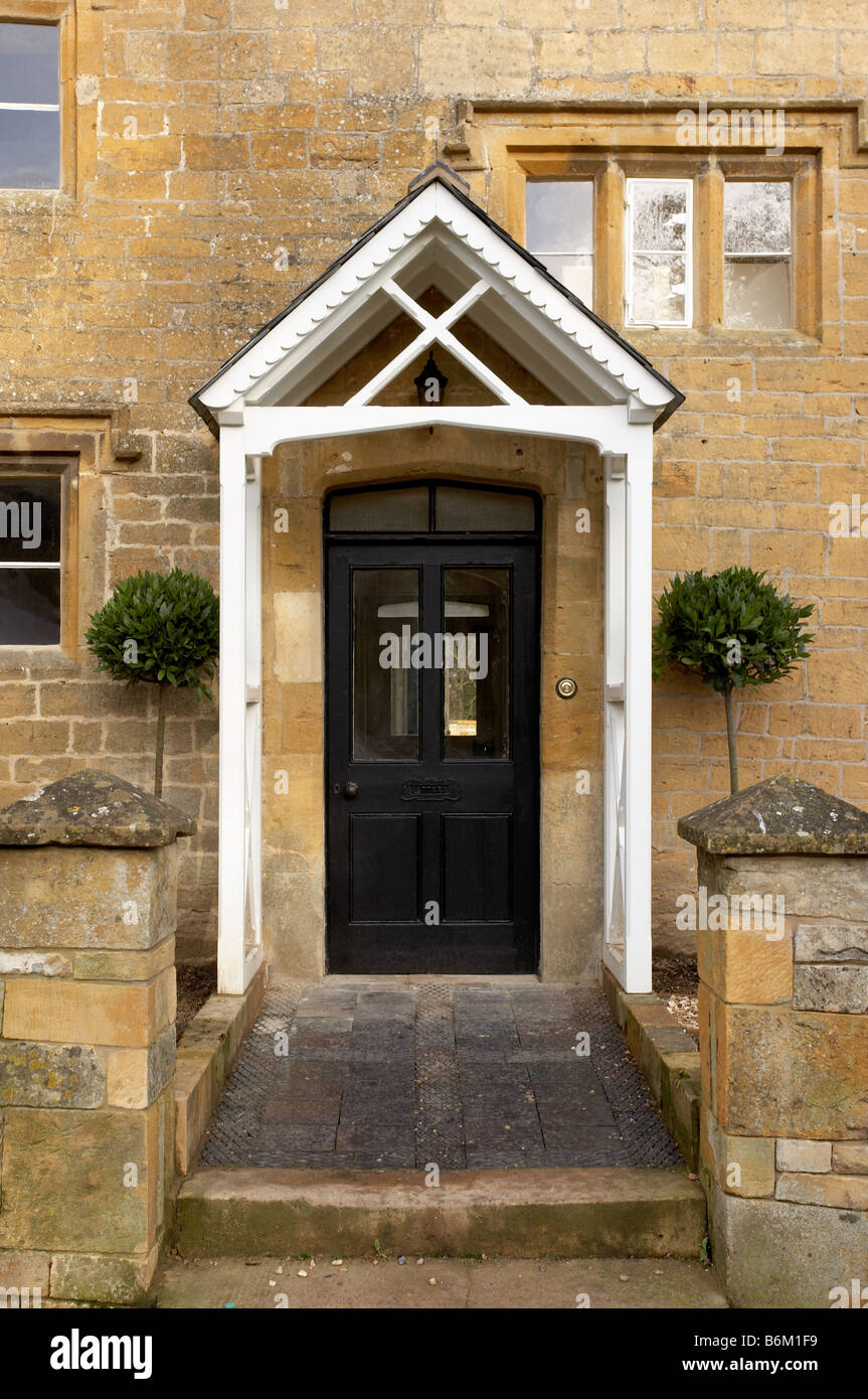 Black front door and white painted porch on a cotswold limestone house. & Black front door and white painted porch on a cotswold limestone ...