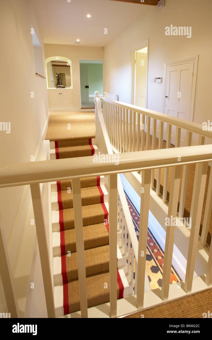 Landing staircase banisters seagrass jute stair runner border - Stock Image