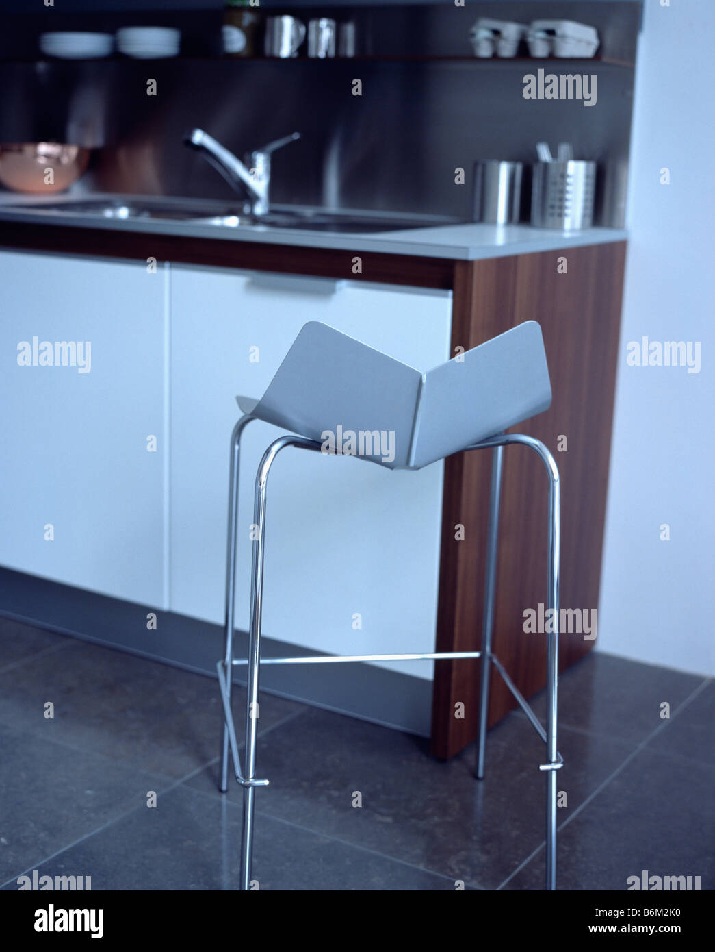 close-up of metal framed blue stool in modern kitchen Stock Photo ...