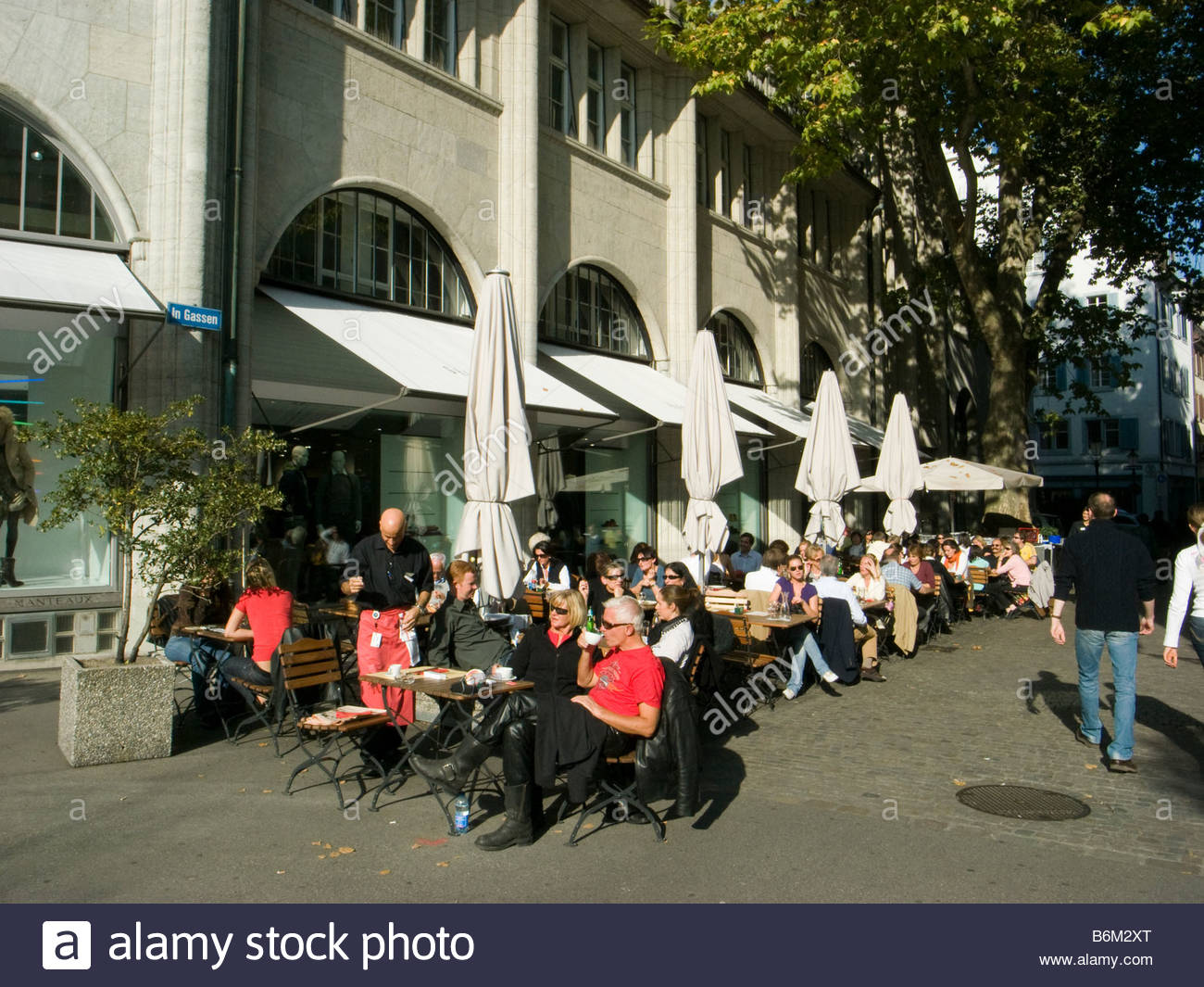 People at oudoor cafe in Zurich Switzerland - Stock Image