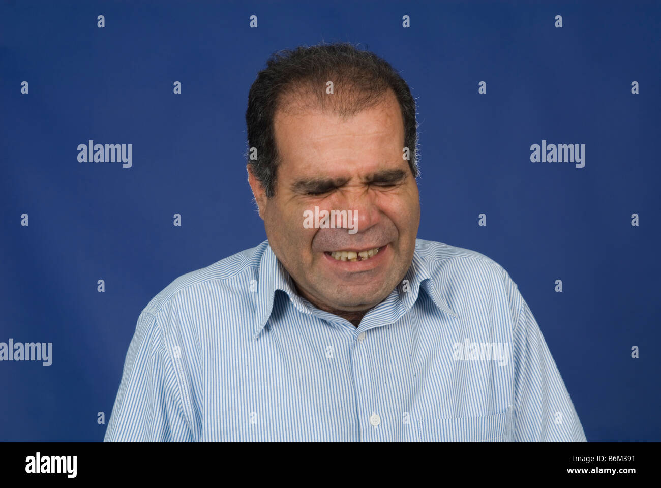 Man with annoyed facial expression - Stock Image