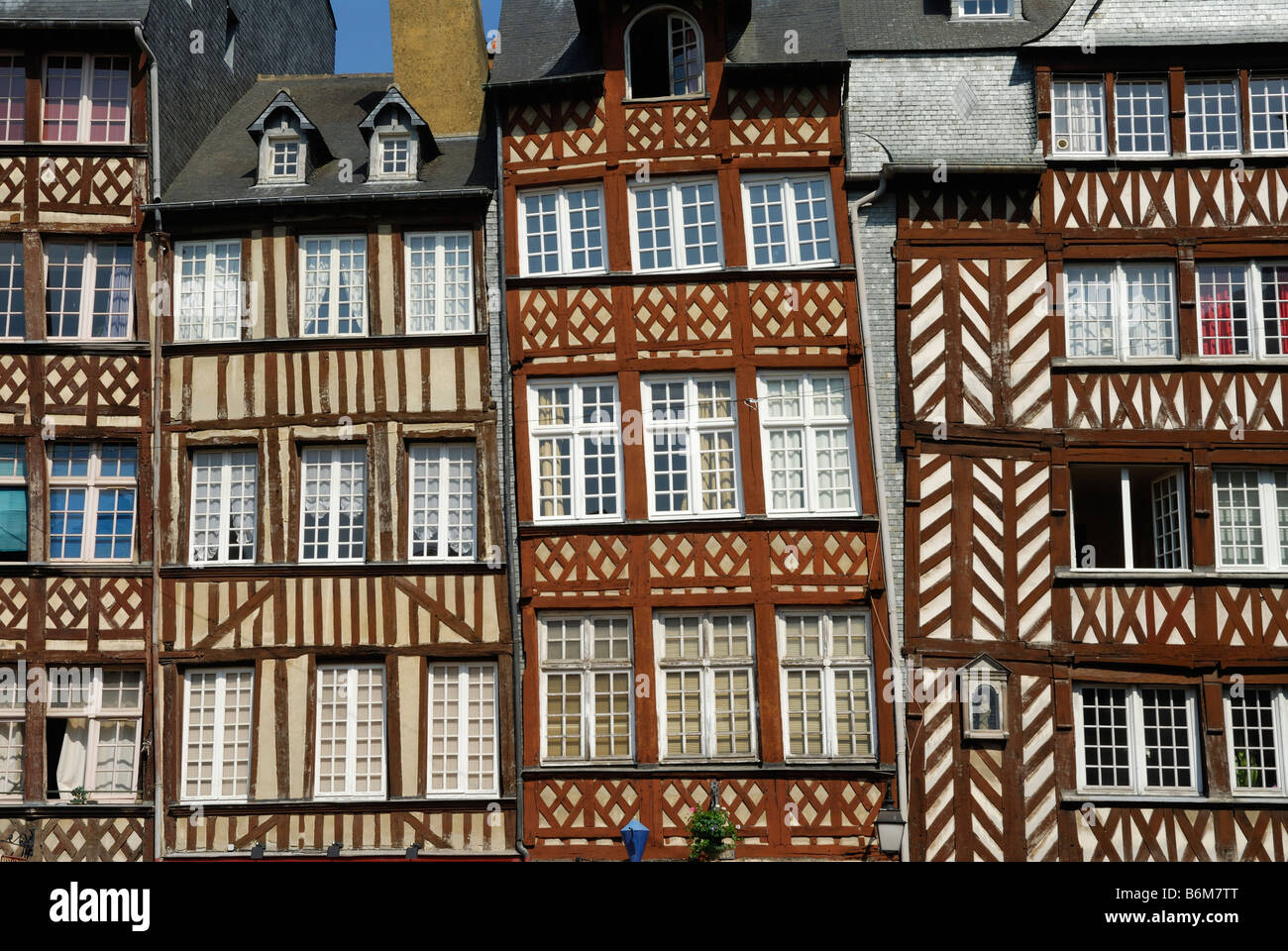 Rennes Brittany France Colourful medieval half timbered buildings on Place du Champ Jacquet - Stock Image