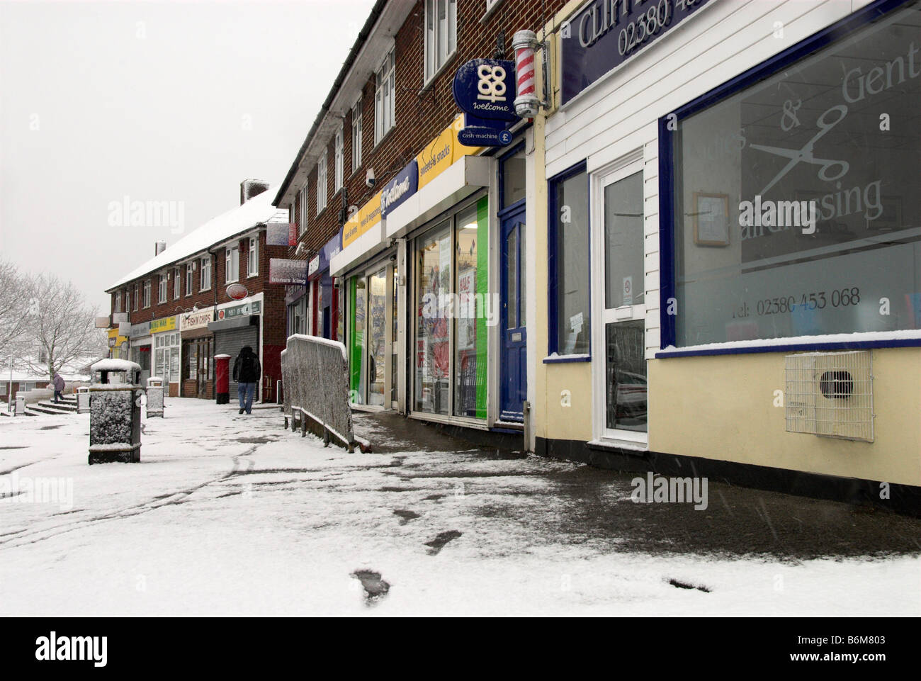 Snow Outside a Parade of Local Shops in A Hampshire Village Stock Photo