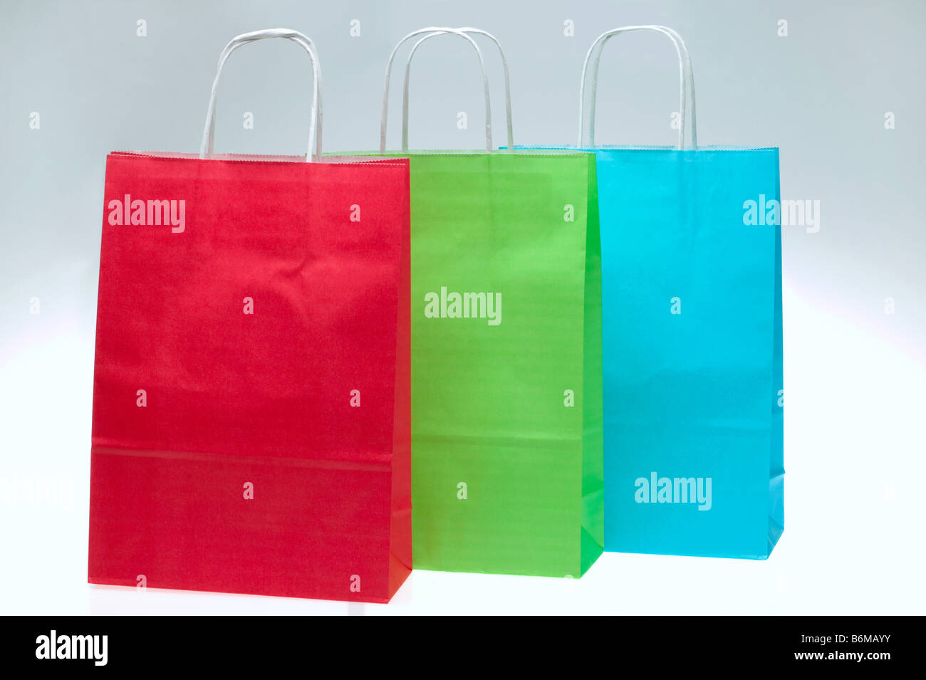 Red Green and Blue paper shopping bags - Stock Image