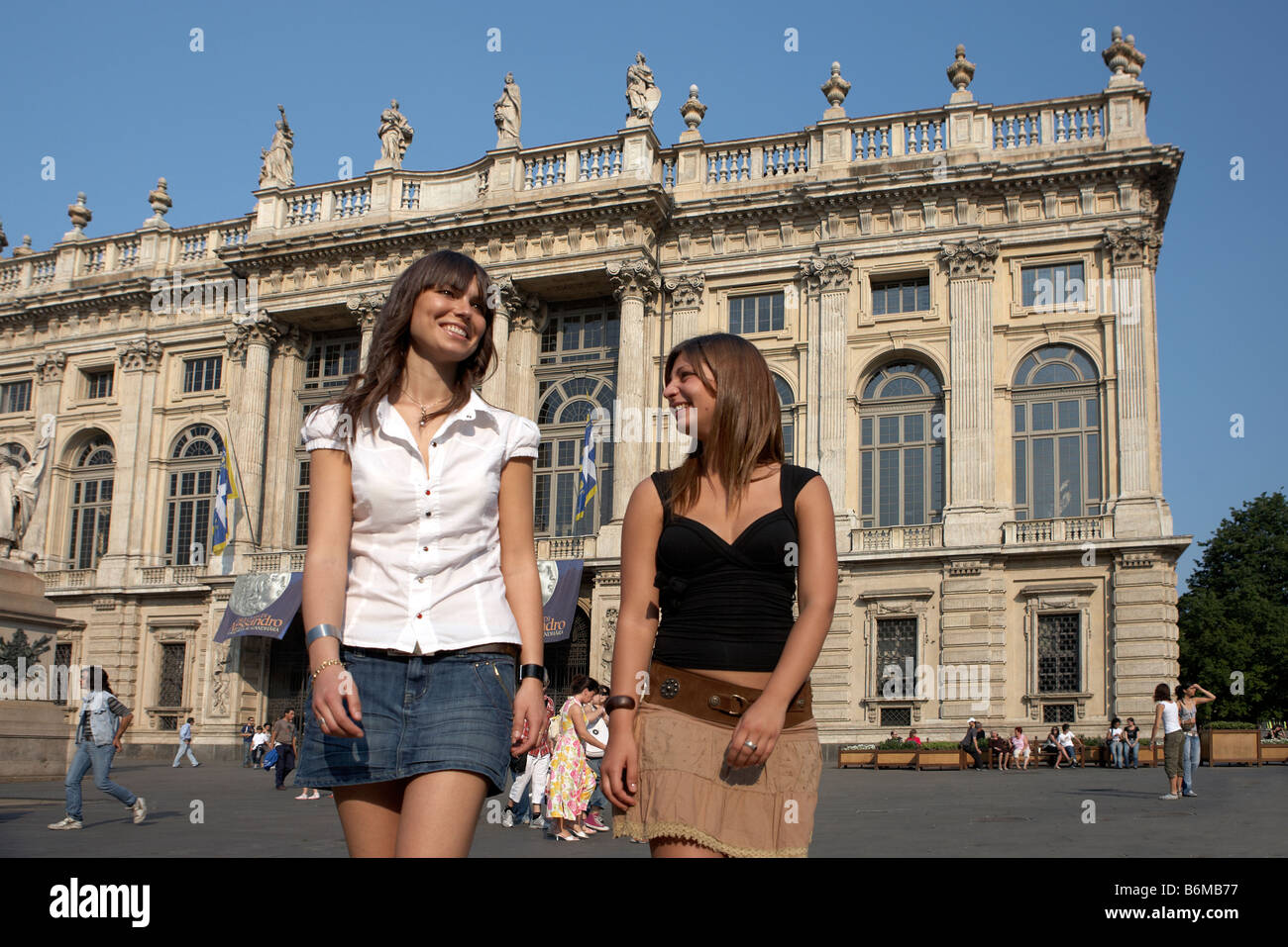 two young attractive women in front of Palazzo Madama. Turin, Italy - Stock Image