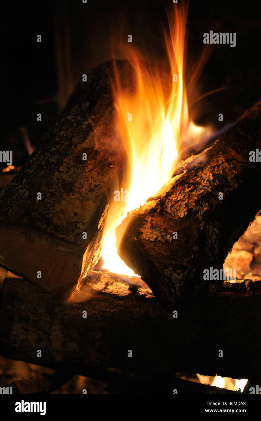 Logs blazing in fireplace - Stock Image