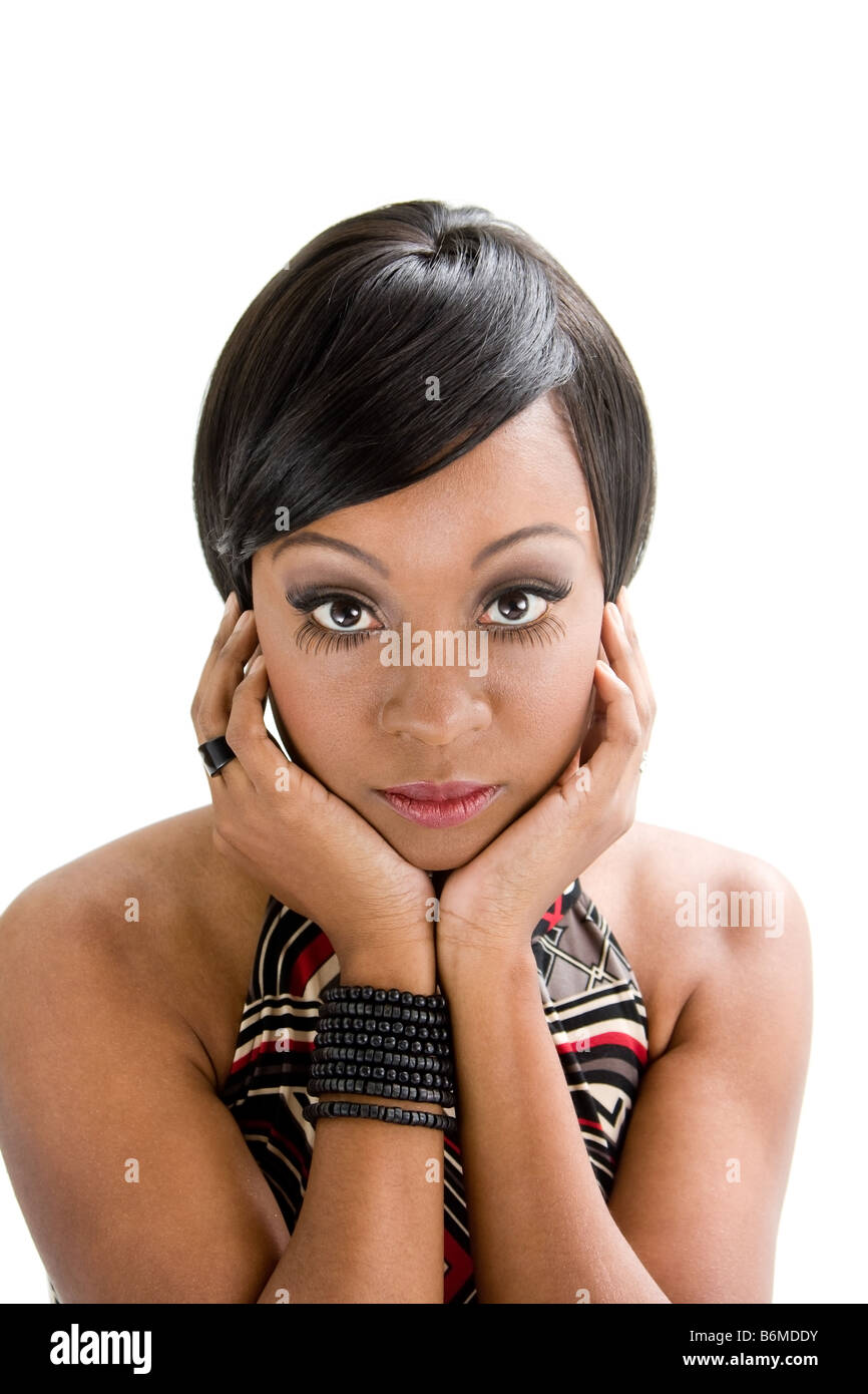 Beautiful African woman with huge eyes seventies style and hands to support face isolated - Stock Image
