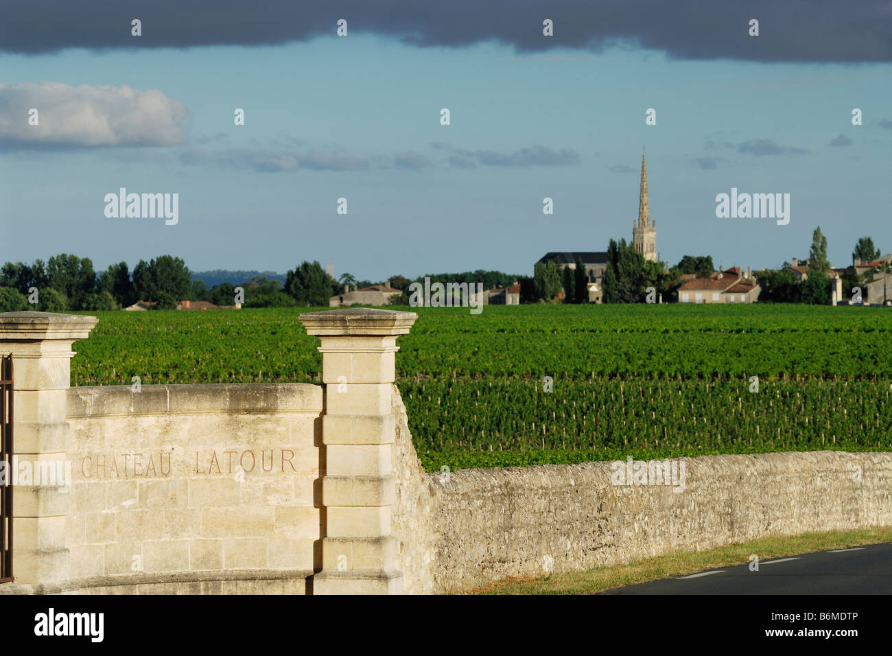 Pauillac France Chateau Latour boundary and the village of St Julien Beychevelle in the distance - Stock Image