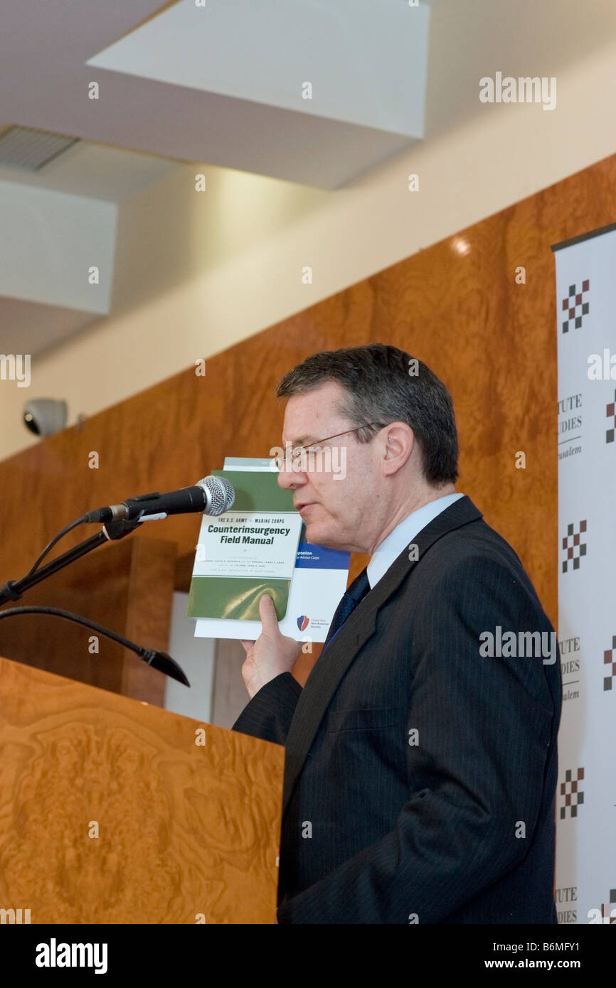 Dr. Martin Kramer, Middle East expert, holds the US Army's Field Manual at a Dec. 2008 counterinsurgency conference. Stock Photo