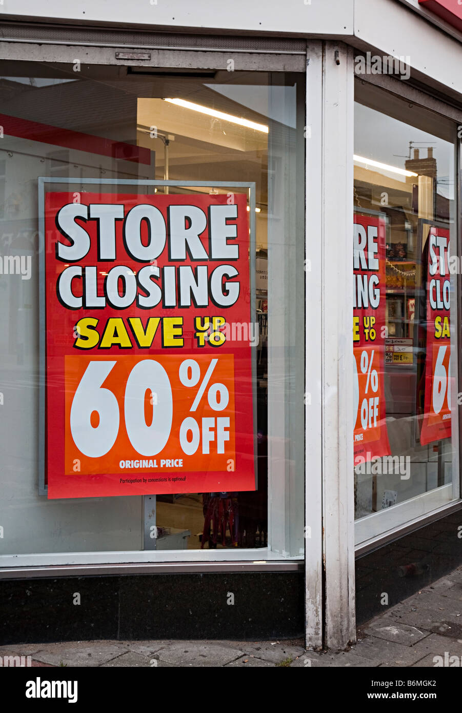 Store Closing sign in shop window of Woolworths Cardiff UK - Stock Image