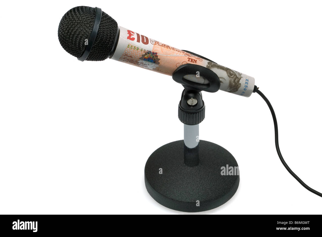 Money talks concept image of a ten pound note around a tabletop microphone isolated on a white background - Stock Image