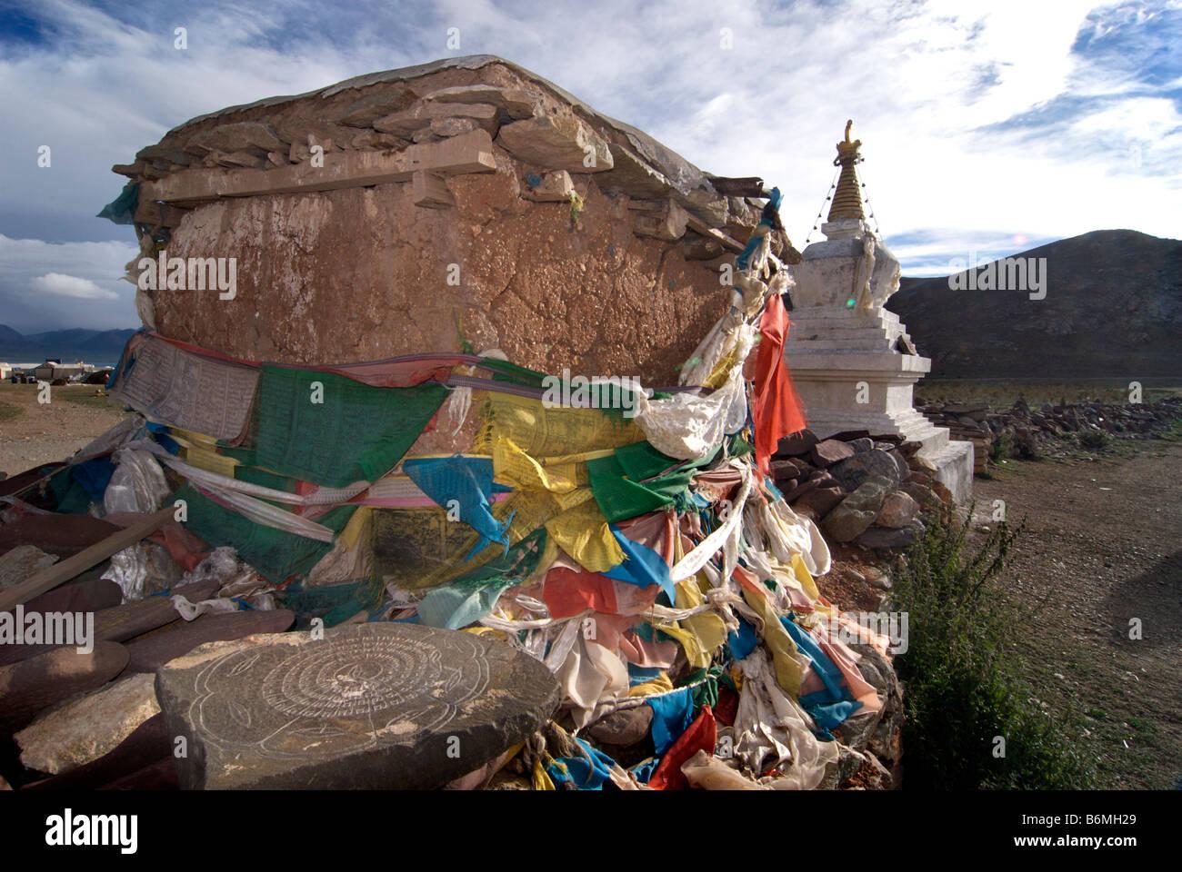 Sacred place wrapped with prayerflags  and stupa. Nam Tso Lake, Tibet - Stock Image