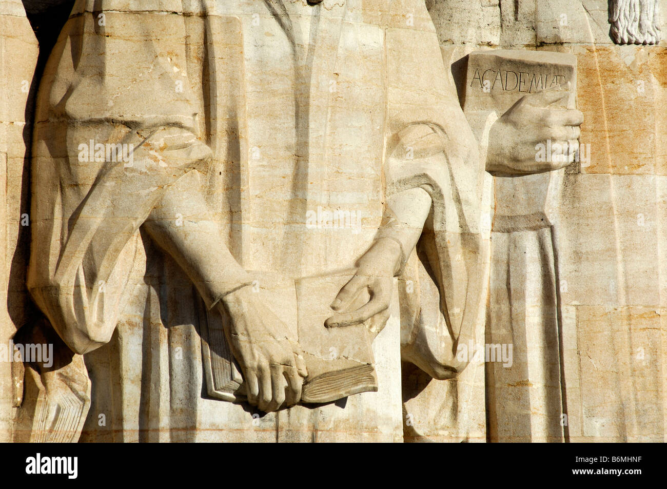 Dtail of the sculptures of John Calvin and Theodore Beza with a book in their hands, Wall of Reformers, Geneva Switzerland - Stock Image