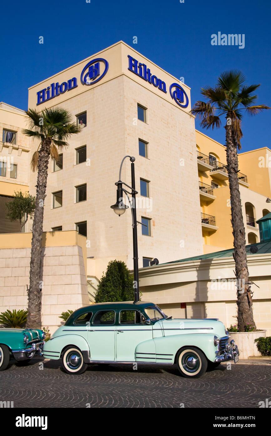 Chevrolet Fleetmaster car parked outside the Malta Hilton Hotel, Portomaso, Saint Julian's, Malta - Stock Image
