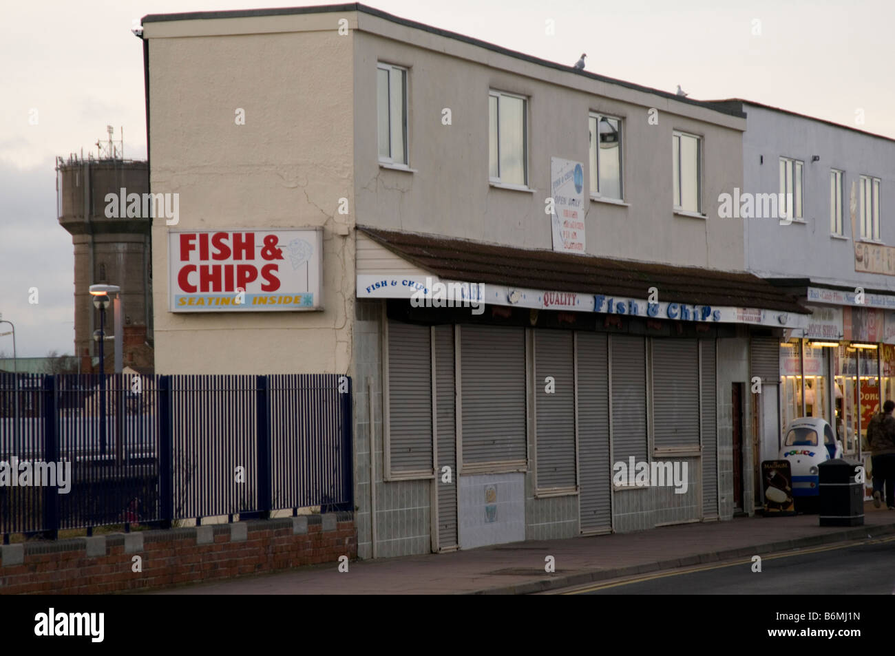 british seaside resort closed for winter boarded up shop retail outlet close uk gb - Stock Image