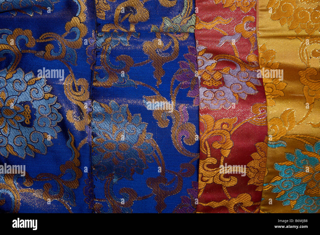 Brocaded fabrics for sale at market. Tibet - Stock Image