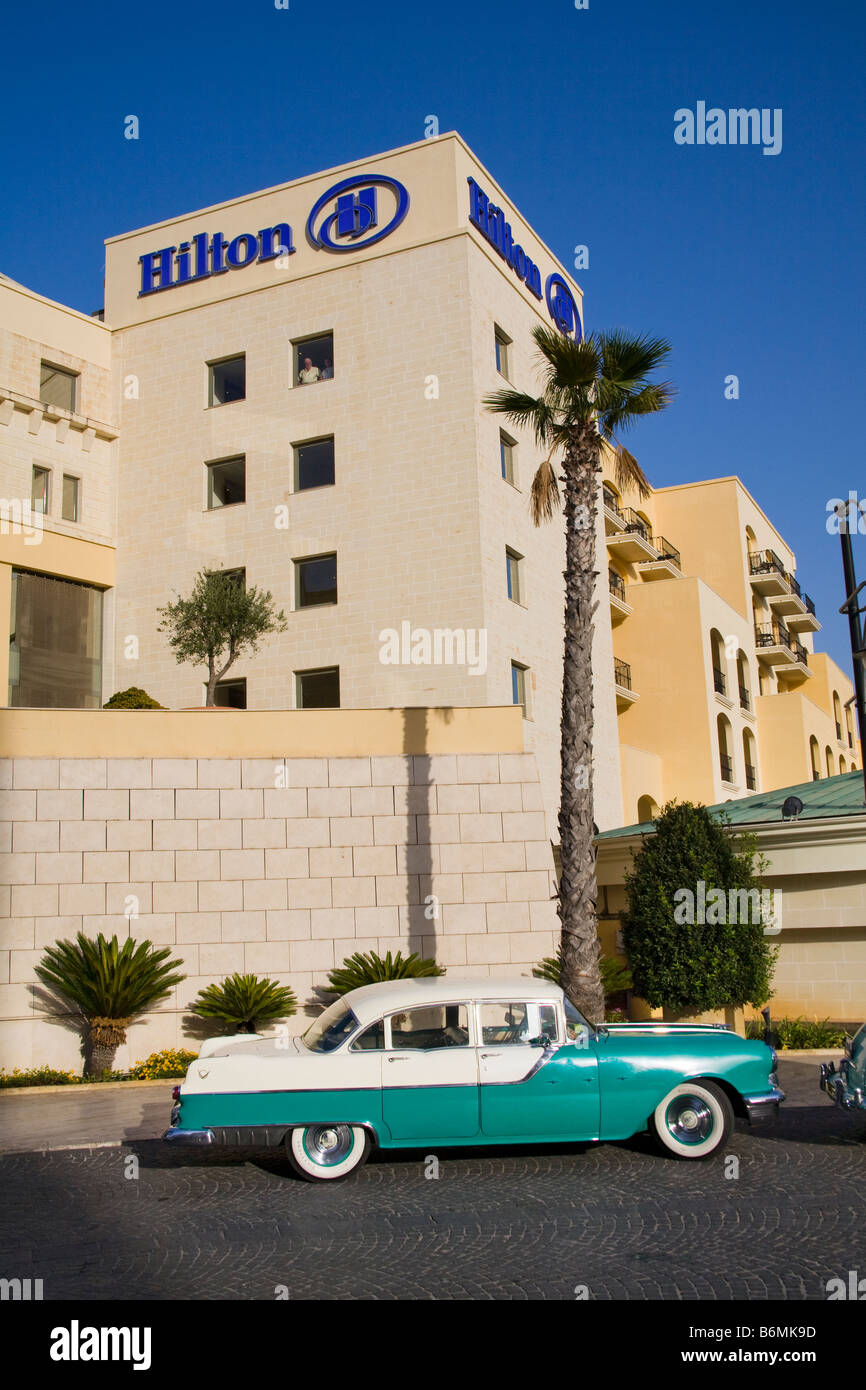 Pontiac Starchief car parked outside the Malta Hilton Hotel, Portomaso, Saint Julian's, Malta - Stock Image