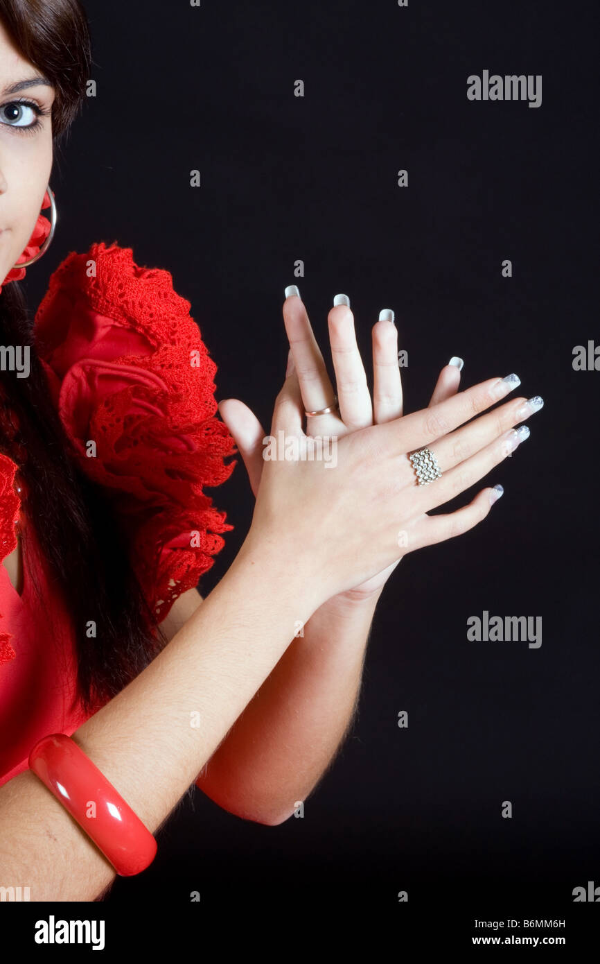 Clapping hands of a young Spanish flamenco dancer - Stock Image