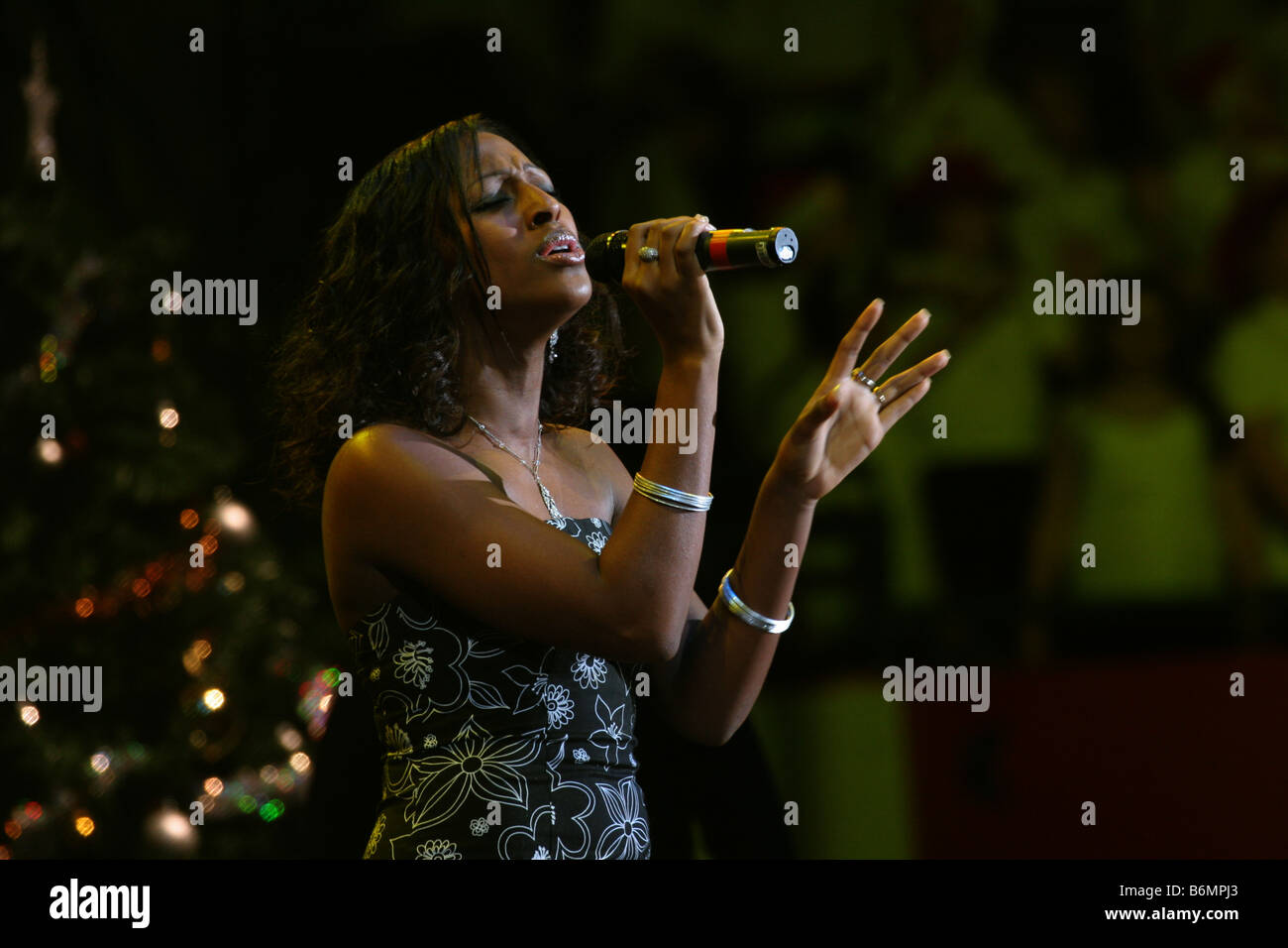 Alexandra Burke pop singer X Factor 2008 winner. Singing during Young Voices Concert Hallamfm  2006 Horizontal 64175 Stock Photo