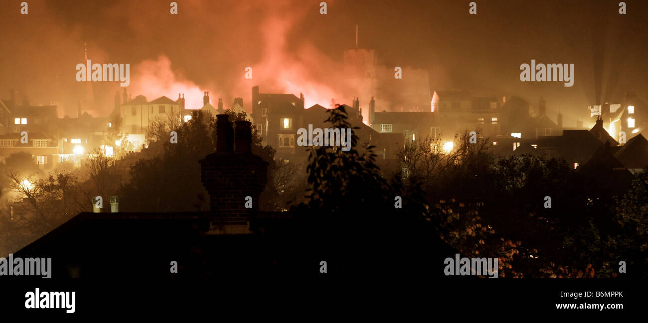 Horizon of Lewes in East Sussex on bonfire night November 5th showing bonfires and fireworks on the high street Stock Photo