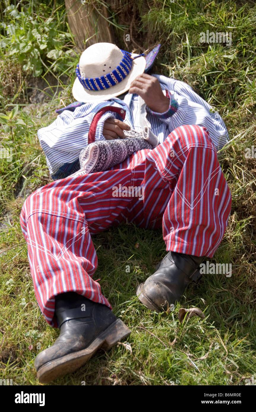 Boozer lays on the grass on his back at the annual festival (Oct 31-Nov 2) .Todos Santos Cuchumatan,Guatemala - Stock Image