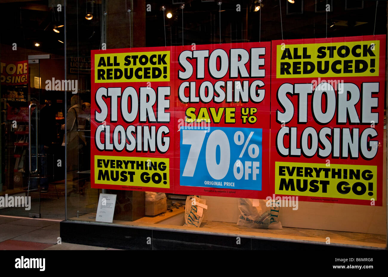 Shop window sale sign display store closing stock reduced, Scotland, UK, Europe - Stock Image