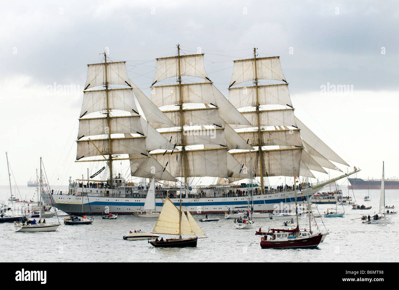 Russian Class A Tall Ship 'Mir surrounded by smaller ships during Funchal 500 Tall Ships Regatta, Falmouth, - Stock Image