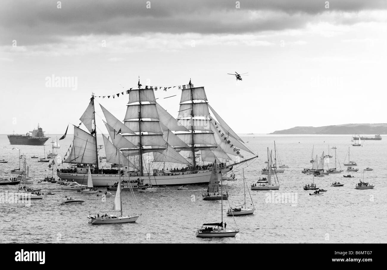 Royal Navy rescue helicopter circling barque 'Cuauhtémoc' during  Funchal 500 Tall Ships Regatta, Falmouth, - Stock Image