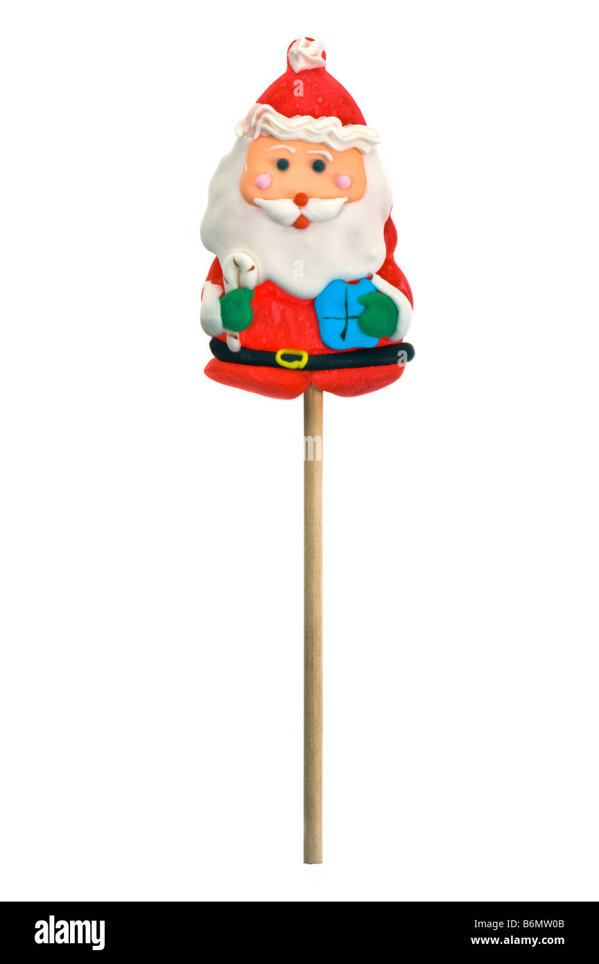 x-mas christmas santa claus father candy cane lollipop lolli lolly sweets girls boys children red white fun funny - Stock Image