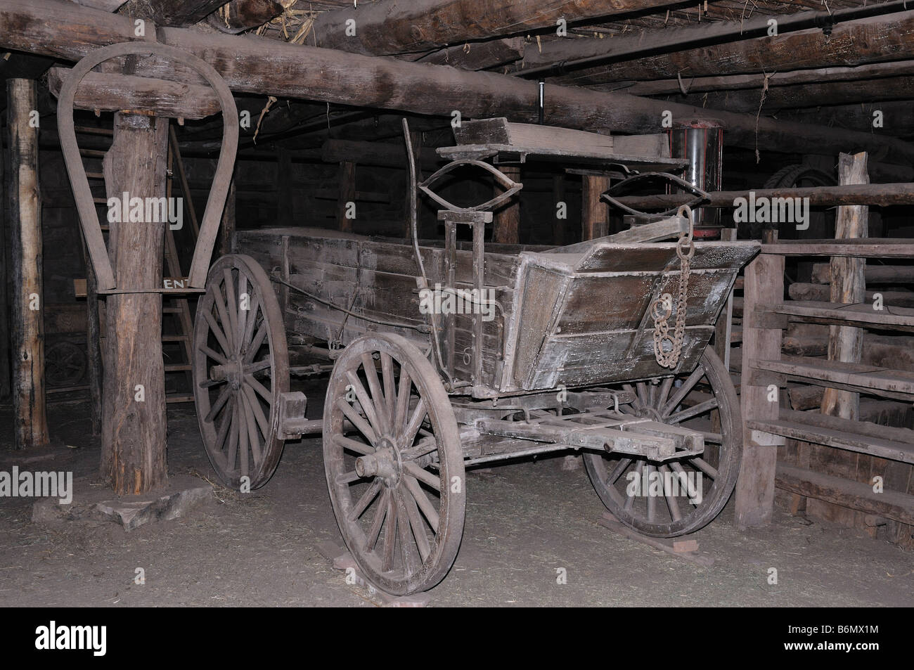 Interior view of the stables at the Hubbell Trading Post in Ganado, Arizona with old wagon and other historical - Stock Image