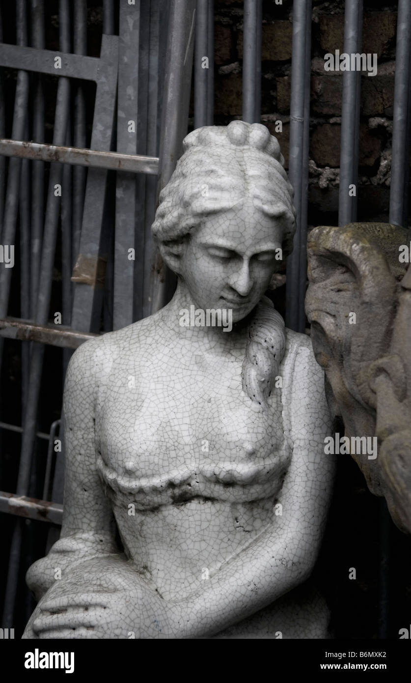 Antique statue of  bare breasted young woman, at the flea market of St Ouen in Paris - Stock Image