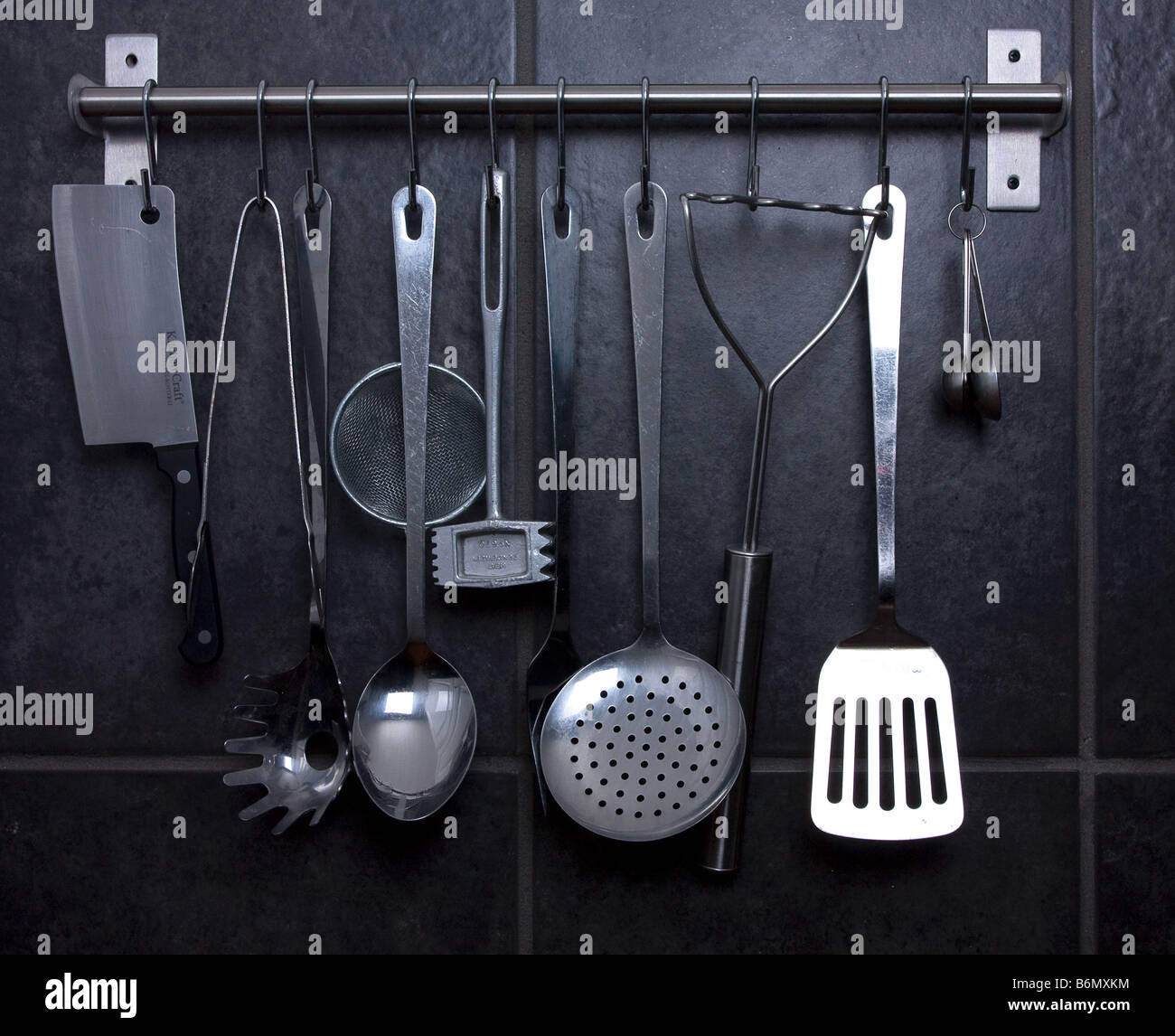 Beautiful Various Stainless Steel Kitchen Utensils Hanging From Ikea Rail Against  Black Slate Effect Tiles