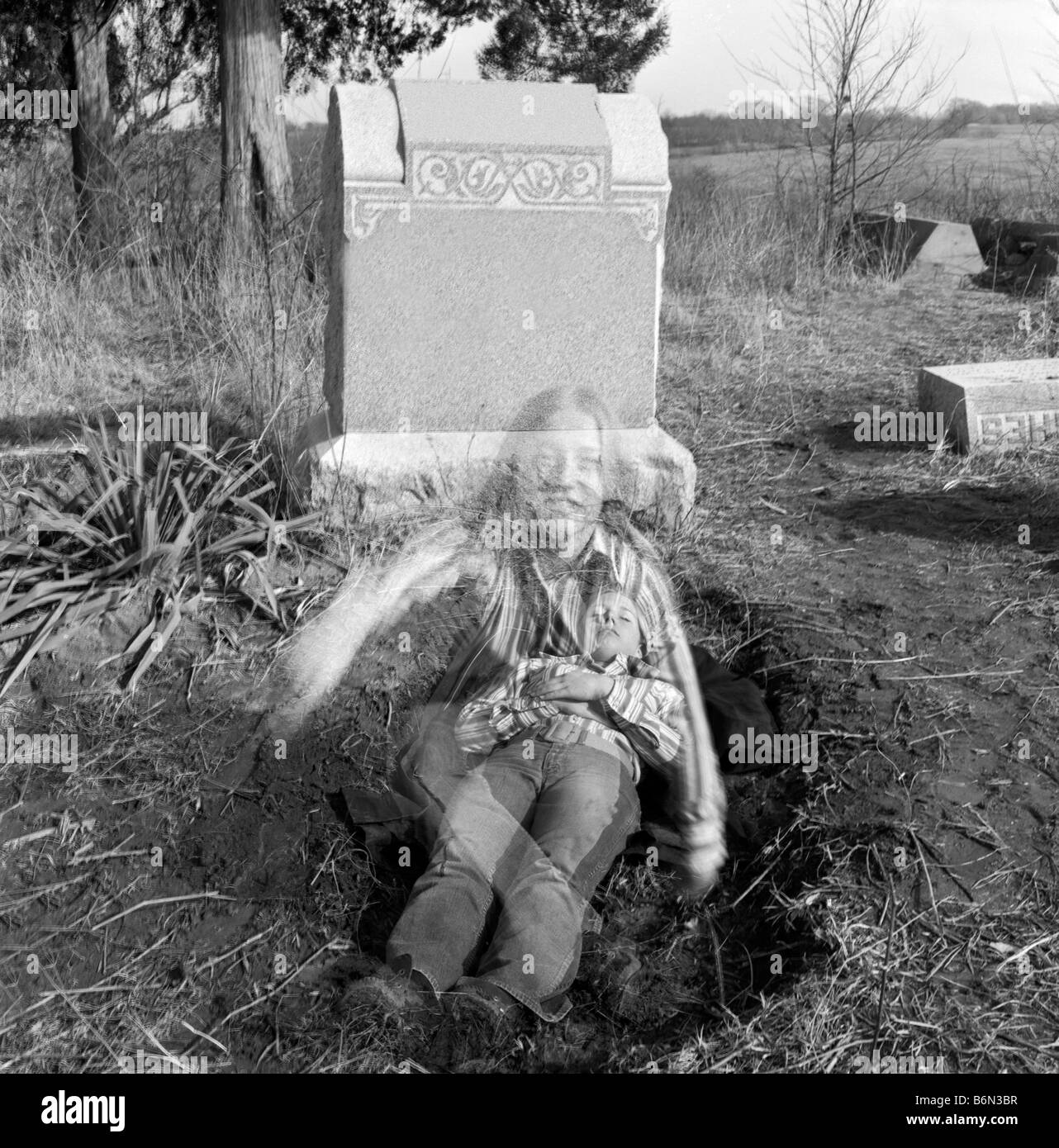 Girl Rising From Dead Coming Out Of Grave Stock Photo
