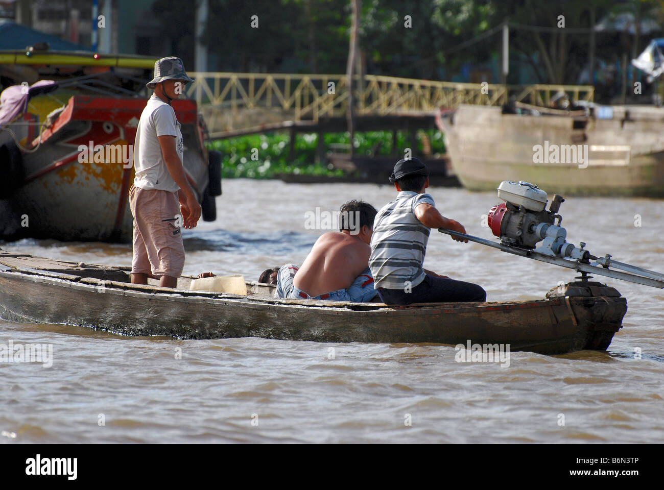 Workers on motorised sampan, town of Cai Be, Mekong Delta, Vietnam - Stock Image