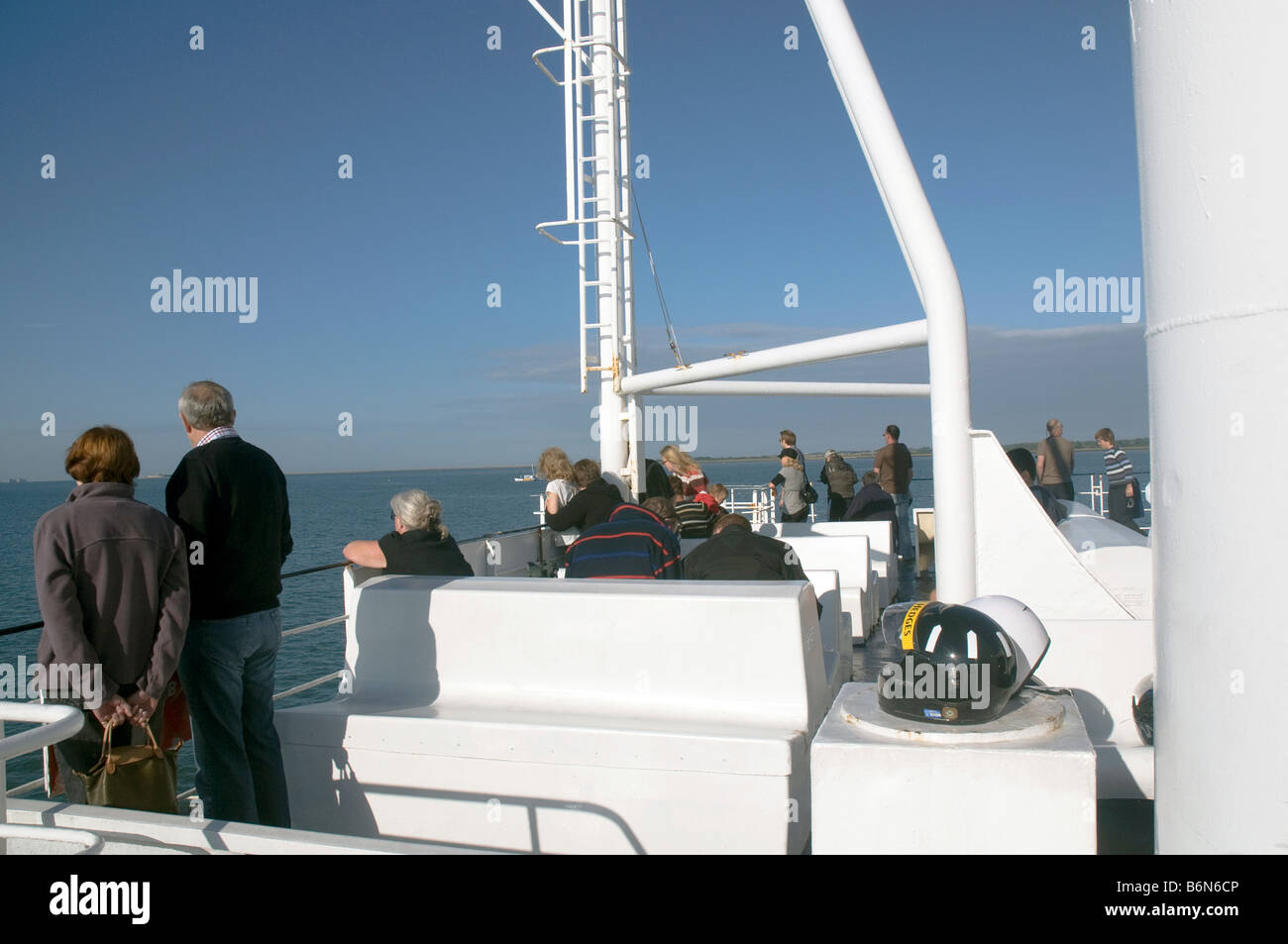 Passengers on the upper deck of the Wightlink Ferry going to Yarmouth on th eIsle of Wight - Stock Image